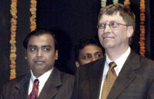 Microsoft chairman Bill Gates (R) and Mu